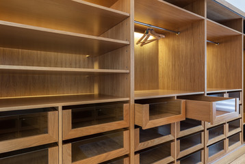 Wardrobe with empty drawers and shelves.