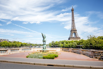 Cityscape view on the Eiffel tower with France Reborn monument in Paris