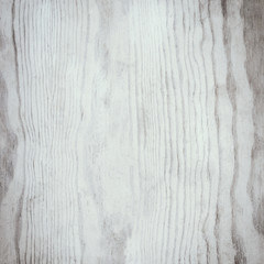 White wooden textured background with natural pattern and scratches. Rustic vintage surface with wood grainy texture. Old table top as  backdrop.