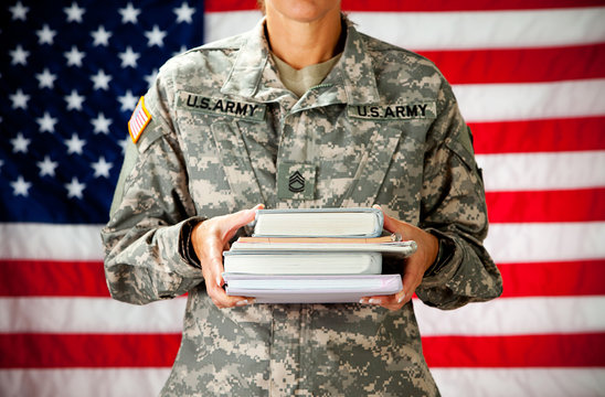 Soldier: Holding Stack of Text Books