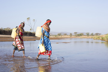Women from Samburu tribe collecting water. Kenya, Africa
