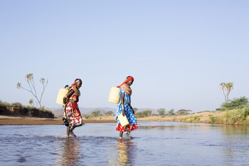 Samburu women collecting fresh water. Kenya, Africa.
