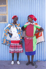 Two women from the Maasai tribe in colourful costume. Kenya, Africa.