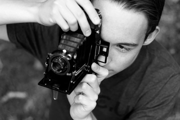 High Angle View Of Man Photographing Through Camera