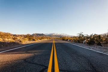 Low Angle View Of Empty Road Passing Through Landscape
