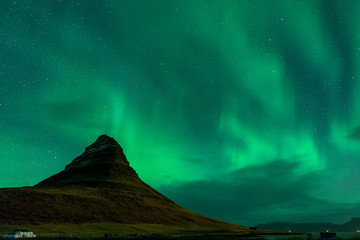 Scenic View Of Mountain Against Aurora Borealis In Sky At Night