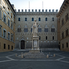 The Salimbeni Palace and the statue of Sallustio Bandini in Siena, Tuscany district. Italy
