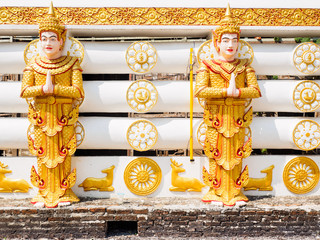 The statues of Deva or Hindu God at the wall of Wangwiwegaram temple in Sangkhlaburi District, Kanchanaburi Province, Thailand