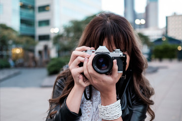 Woman traveling and exploring in the city with a camera