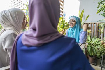 3 Muslim Ladies having a conversation