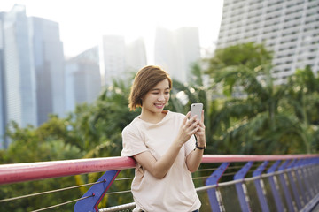 Portrait of a beautiful young lady taking a selfie at Gardens by the Bay, Singapore