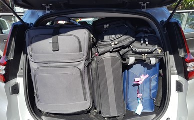 Car trunk packed with luggage