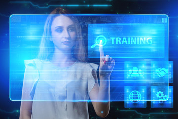 The concept of business, technology, the Internet and the network. A young entrepreneur working on a virtual screen of the future and sees the inscription: Training