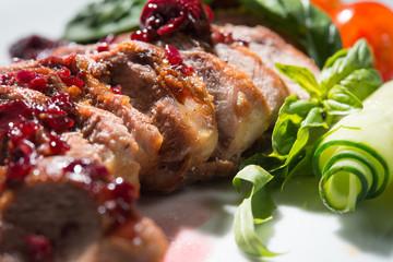 baked duck fillet in cherry sauce sliced chunks