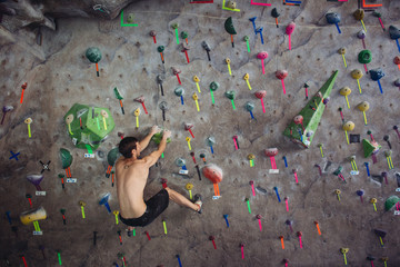 Free Climber on bouldering wall