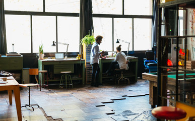 Young entrepreneurs working in a creative office.