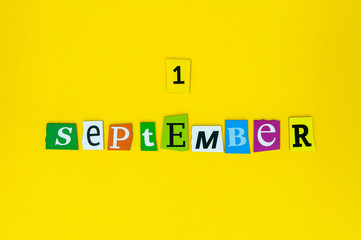September 1st. Image of september 1 Carved letters calendar on yellow background. Autumn day. Back to school time