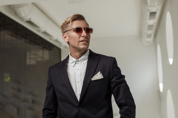 Classy man in suit and sunglasses