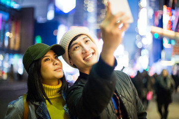 Asian tourists take a selfie in Time Square
