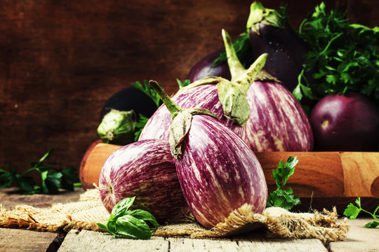 Fresh purple striped eggplants, rustic style, selective focus