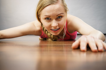 Young woman lying on floor face closeup