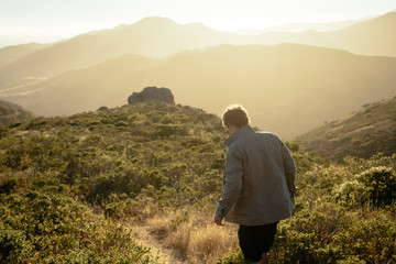Young man explore the hills of california
