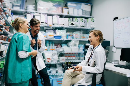 Hospital staff having casual discussion in the pharmacy