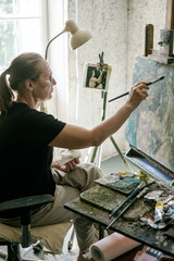 Female Artist Working on the Painting