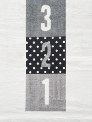 Numbers 3,2,1 on a textured surface