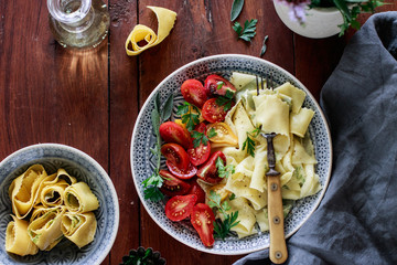 Herb pappardelle with tomatoes and parmesan