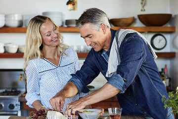 Mature couple cooking in the kitchen together