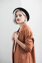 Fashionable young woman wearing a hat