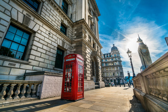 Big ben on the background and red telephone booth in London at sunrise