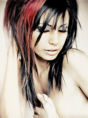 Beautiful woman red and black wild hair