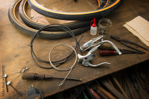 Bicycle repair  Repairing or changing a tire, brakes etc of an