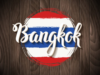 Bangkok vector lettering and thai national flag on vintage wooden background. Bangkok city hand drawn typography. Vintage calligraphy design