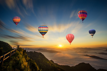 Fotobehang Rudnes Colorful hot-air balloon flying over the mountain