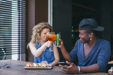 Loving couple make a toast at their first appointment during aperitif