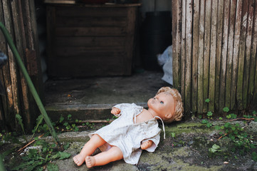 the old doll is left in the doorway of an old abandoned building. Fear of loneliness.
