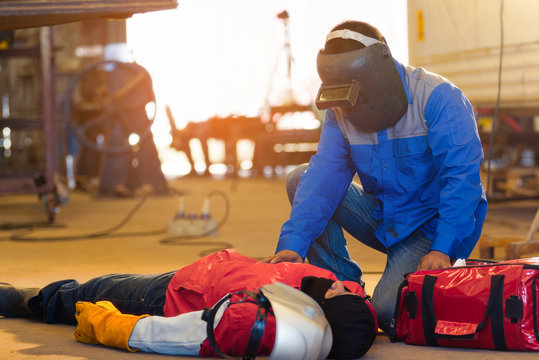 First aid training in the factory industrial. Welder accident in works and fainting in a factory industrial.