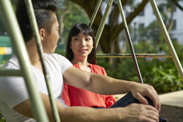Couple having a quiet time on a swing in Tanjong Pagar, Singapore