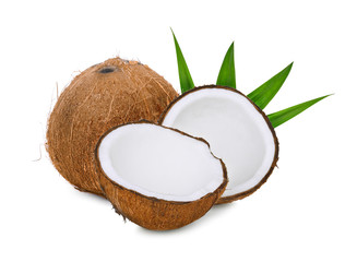 whole and half of dry coconut with green leaves isolated on white background