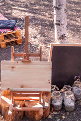 Wooden easel with a clean board