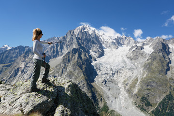 Hiker woman in front of Mont Blanc