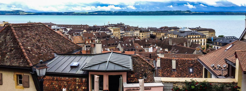 Top view of the medieval town Neuchatel with Lake Neuchatel and the Bernese Alps Chaumont seen on the horizon.