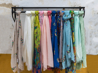Colorful scarves on Iron Hanger in a Store
