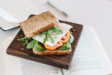 Sandwich with vegetables on book