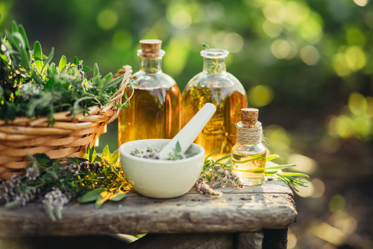 Spa composition with Fresh herbs and different types of oils.