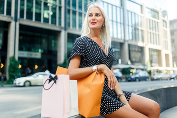 Blonde with purchases in dress