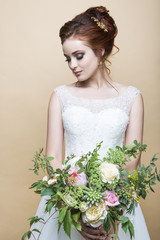 Young pretty bride with wedding bouquet